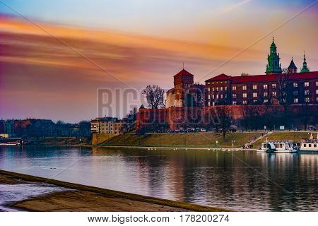 Royal castle of the Polish kings on the Wawel hill, over the Vistula river in beautiful sunset light, Krakow, Poland