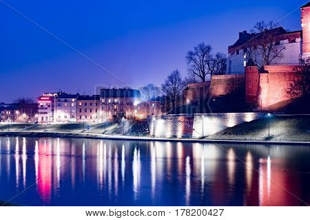 Royal castle of the Polish kings on the Wawel hill, over the Vistula river in the evening, Krakow, Poland