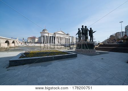 Skopje, Macedonia, march 20, 2017: View of the Archeological museum and the Eye Bridge in Skopje decorated with many sculptures.