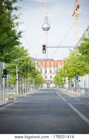 an empty street in berlin, with the tv-tower at alexanderplatz visible in the background.
