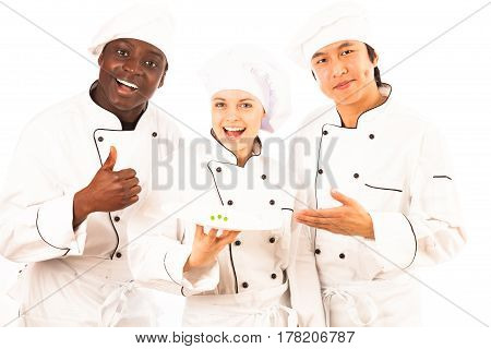 Studio shot of multi-ethnic group of cooks presenting their new creation for people on a diet