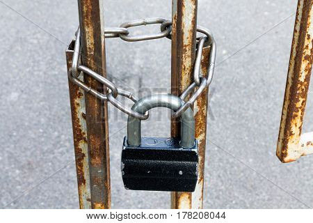 Padlock And Chain. The Passage Is Closed. Locked Gates.