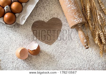 heart of flour on the Table-Basic baking ingredients top view