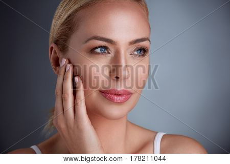 Pretty middle age woman with perfect skin, natural beauty