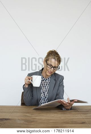 Woman Reading Magazine Hand Hold Cup