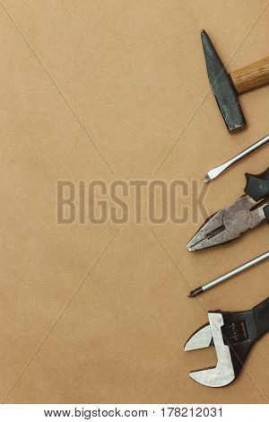 Authentic worn various tools on border with copyspace. flat lay. top view