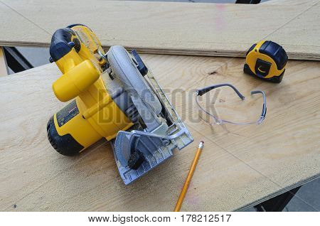 Circular Saw, Tape Measure, Pencil and Safety Glasses