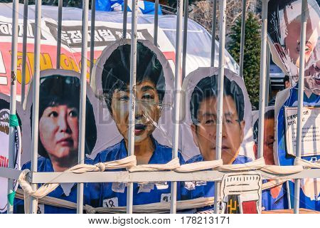 SEOUL South Korea March 18 2017:Mock jail cell in central Seoul with pictures of Impeached ex-president Park Gun Hye Choi Soon Sil and Hwang Gyo Hal behind bars