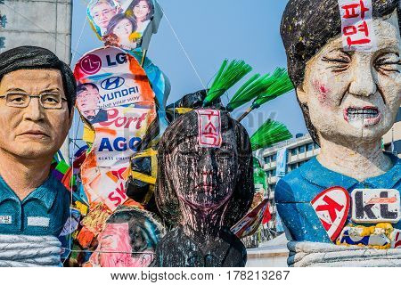 SEOUL South Korea March 18 2017: Effigies of impeached ex-president Park Gun Hye Choi Soon Sil and Hwang Gyo Hal in central Seoul