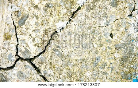 Grunge concrete cement wall with crack in industrial building, great for your design and texture background.