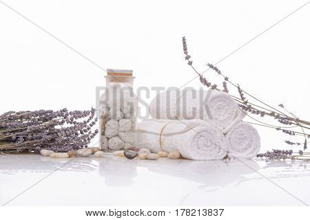 lavender with three rolled towel and herbal ball ,stones in bottle for spa setting