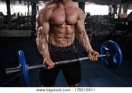 Athlete Muscular Bodybuilder In Gym Training With Bar.