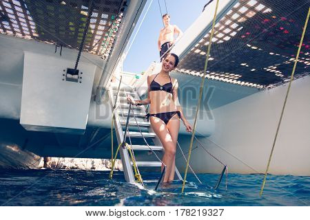 a young fashionable couple on their catamaran