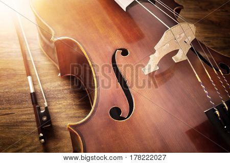 Cello on wood background with copy space for music concept
