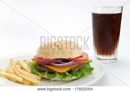 A burger meal with coke and fries on a white plate