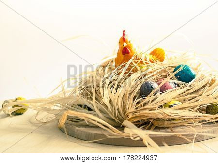 Happy Easter. Chicken In The Nest And Colored Eggs