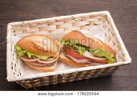 Ham with vegetables sandwich in a lunch box