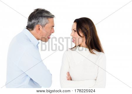 Angry couple sticking out tongue on white background