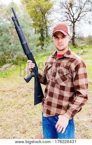 Portrait of Young Man Hunting With Shotgun