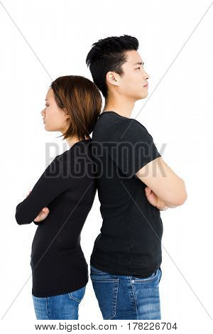 Depressed couple standing back to back on white background