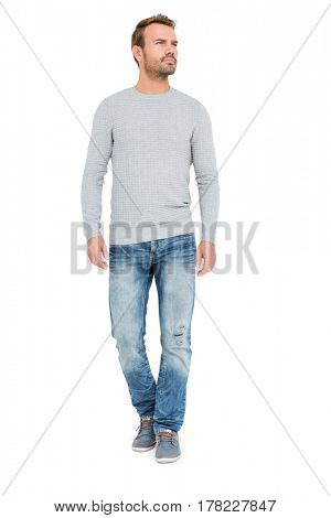 Young man standing and looking away on white background