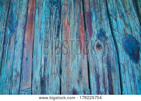 beautiful background of wooden boards discolored in day