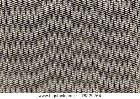 the abstract textured background of beige color of polymeric material or synthetic fabric with a corrugated symmetric pattern and with small droplets of water