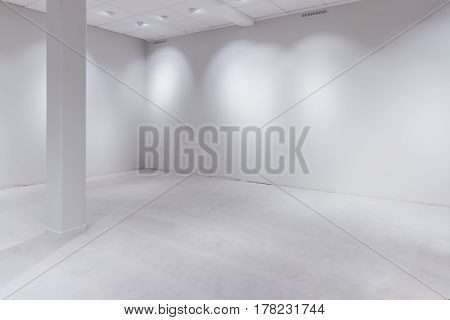 Spot lights and blank white wall as copy space empty department store or warehouse