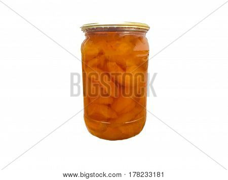 Apricot jam in a glass jar on a white background