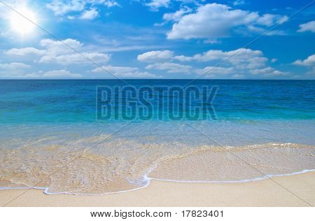 Idyllic beach with summer sky and direct sun
