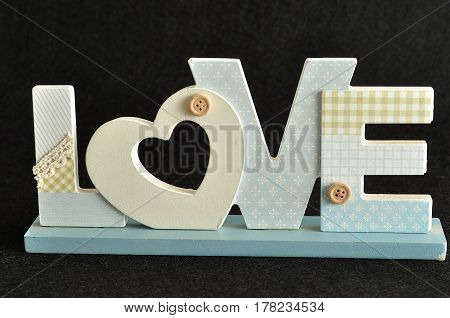 Valentine's Day. Love in blue letters isolated on a black background