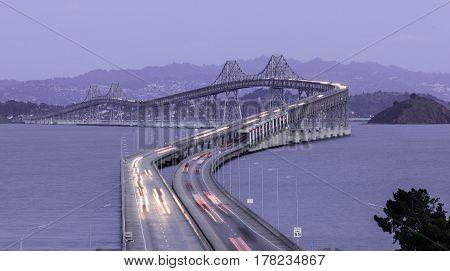 Dusk Over The Richmond-San Rafael Bridge from San Quentin, Marin County, California, USA.