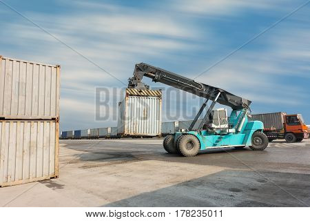 Container unloading truck in logistics yard., Business transportation.