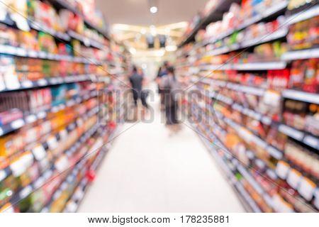 Supermarket and storage shelf on blur scene.
