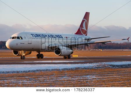 Riga, Latvia - January 16, 2014: Turkish Airlines, Airbus A320 running on the taxiway Riga RIX Airport, Latvia.