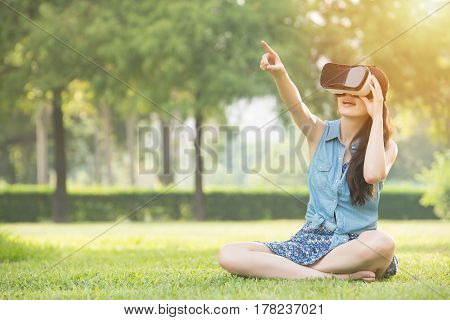 Beautiful Asian Woman Touch Scrrn With Vr Headset