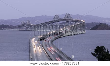 Dusk Over The Richmond-San Rafael Bridge. Shot from San Quentin Point, Marin County, California, USA.