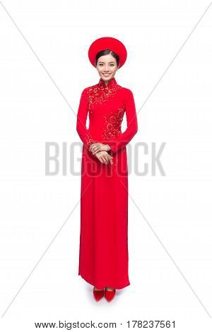 Full Length Of Vietnamese Bride In Red Ao Dai Traditional Dress With Hat.