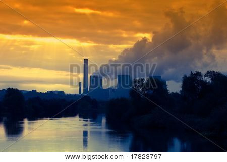 Global Warming concept, power station in early morning sunrise