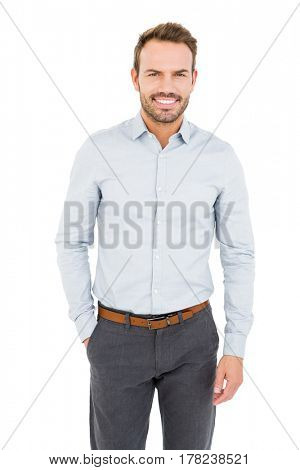 Confident and well dressed young man smiling at camera on white background