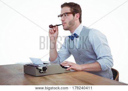 Handsome man using old fashioned typewriter on white background