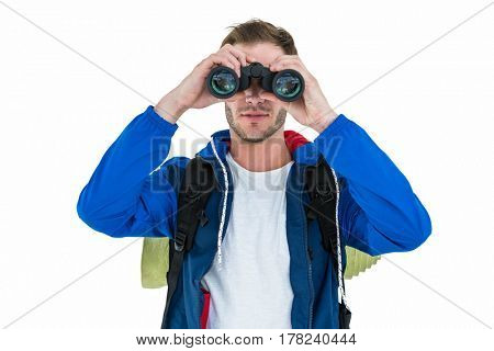 Backpacker hipster looking through binoculars against white background