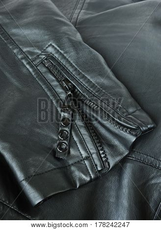 Sleeve of a leather jacket close up