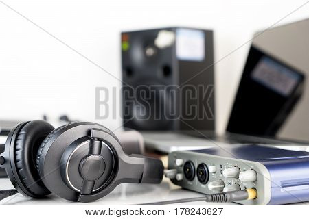 Music Studio headphone lying on working desktop
