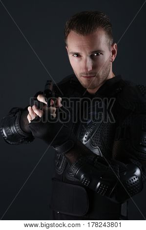 Super Cops- Handsome blond man holding a gun