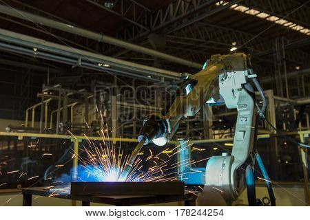 Robot is welding assembly automotive part in factory
