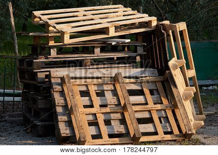 old wooden pallets for recycling in the factory