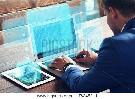 Business technology internet and networking concept. Young businessman working on his laptop in the office.