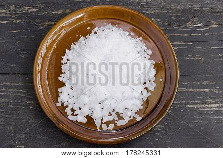 Magnesium chloride flakes full saucer top view