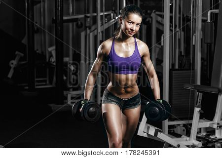Sexy Young Girl Resting Doing Sport Workout Exercises With Dumbbells